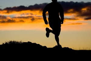 Adventure:  A man trail running at sunset near Frenchman Coulee, Vantage